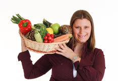 Smiling girl with vegatables Stock Image