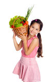 Smiling girl with vegetables Royalty Free Stock Photography