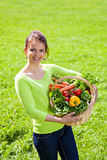 The smiling girl with vegetables outdoors Royalty Free Stock Image