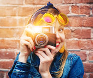 Smiling girl with vintage camera Stock Photos