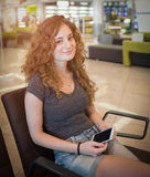Smiling girl  waiting in the airport Stock Image