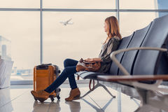 Smiling girl waiting for boarding royalty free stock photos