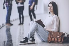 Smiling Girl is Waiting for Lecture in the Hall. Studying festyle. Education and Careere Concept. Studying in University. Science and Leagning. Female Student royalty free stock photos
