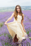 Smiling girl is walking at lavender field Royalty Free Stock Images