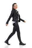 Smiling Girl Walking In Leather Clothes Royalty Free Stock Photo