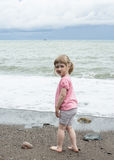 Smiling girl walking near the seashore Stock Photo