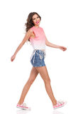 Smiling Girl Walking in Pink Sneakers Stock Photos