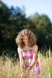 Smiling girl walking through tall grass Royalty Free Stock Image