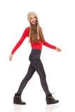 Smiling girl walking in winter hat Royalty Free Stock Image
