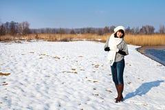 Smiling girl walking at winter lake Stock Images