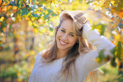 Smiling girl among warm autumn colors Royalty Free Stock Photo