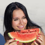 Smiling girl with water-melon Royalty Free Stock Photography