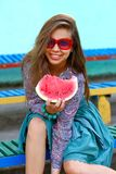 Smiling girl with watermelon Royalty Free Stock Image