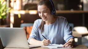 Free Smiling Girl Wear Wireless Headphone Study Online With Skype Teacher Stock Photos - 157342283