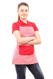 Smiling girl wearing an apron and looking at camera Royalty Free Stock Images