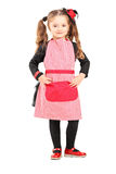 Smiling girl wearing apron and posing Royalty Free Stock Photos