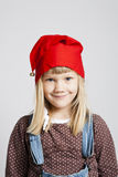 Smiling girl wearing Christmas hat. Closeup studio portrait of smiling young girl wearing red Christmas hat Royalty Free Stock Photography
