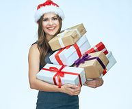 Smiling girl wearing christmas hat hold gift box. Business dress. Isolated portrait Stock Photography
