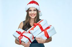 Smiling girl wearing christmas hat hold gift box. Business dress. Isolated portrait Stock Images