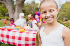 Smiling girl wearing a costume during a birthday party Stock Photos