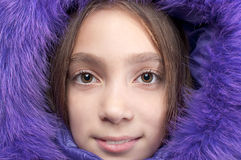Smiling girl wearing fur hood Stock Photography