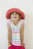 Smiling girl wearing Panama standing Stock Image