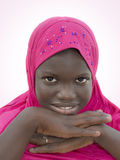 Smiling girl wearing a pink headscarf, ten years old Stock Photos