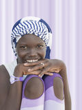 Smiling girl wearing a striped headscarf, ten years old Royalty Free Stock Images