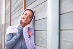 Smiling girl wearing sweatshirt with hood Royalty Free Stock Photos