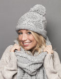 Smiling girl wearing wool winter clothing for warmth and comfort Royalty Free Stock Photos