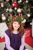 Smiling girl wearing an Xmas candle wreath Royalty Free Stock Photos