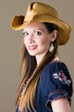 Smiling Girl in Western Outfit. An attractive young brunette woman in a western outfit Stock Image