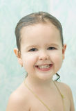 Smiling girl with wet hair Stock Images