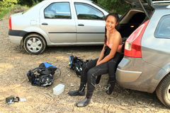 Smiling girl in wetsuit Stock Images