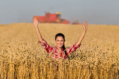 Smiling girl in wheat field Stock Images