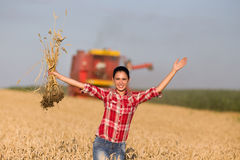 Smiling girl in wheat field Royalty Free Stock Photos