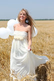 Smiling girl with white balloons Royalty Free Stock Photos