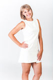 Smiling girl in white dress. On white background Stock Photos