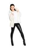 Smiling girl in white fur coat Royalty Free Stock Photos
