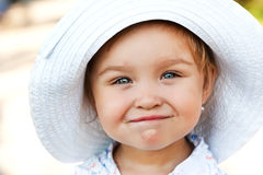 Smiling girl in a white hat Stock Photo