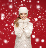 Smiling girl in white hat, muffler and gloves Royalty Free Stock Photo