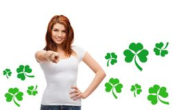 Smiling girl in white t-shirt pointing at you. Gestures, holidays, st. patricks day and people concept - happy teenager in blank white t-shirt pointing at you Stock Photography