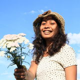 Smiling girl with wild flowers Stock Images
