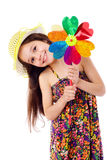 Smiling girl with windmill Stock Images