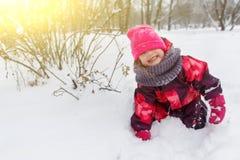 Smiling girl among winter bushes Stock Photo