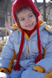 Smiling girl in winter clothes royalty free stock photography