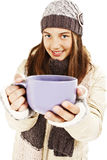 Smiling girl in winter clothes with a big cup Royalty Free Stock Photos