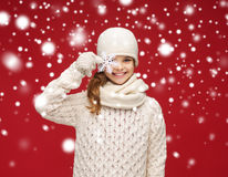 Smiling girl in winter clothes with big snowflake Royalty Free Stock Photography