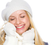 Smiling girl in winter clothes enjoying soft scarf Royalty Free Stock Images