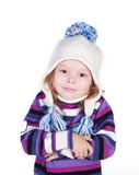 Smiling girl in winter clothes who is cold. Cute girl in winter clothes who is cold isolated over white Royalty Free Stock Images